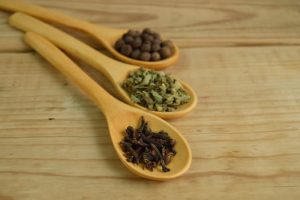 Herbs and spices in three spoons