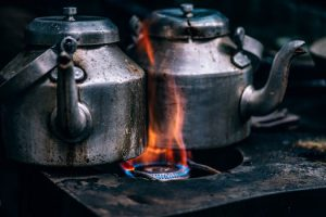 Tea pots over flame