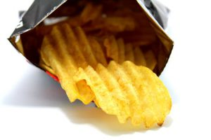 Chips falling out of a bag