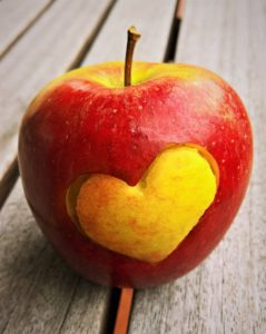 Apple with heart carved in it